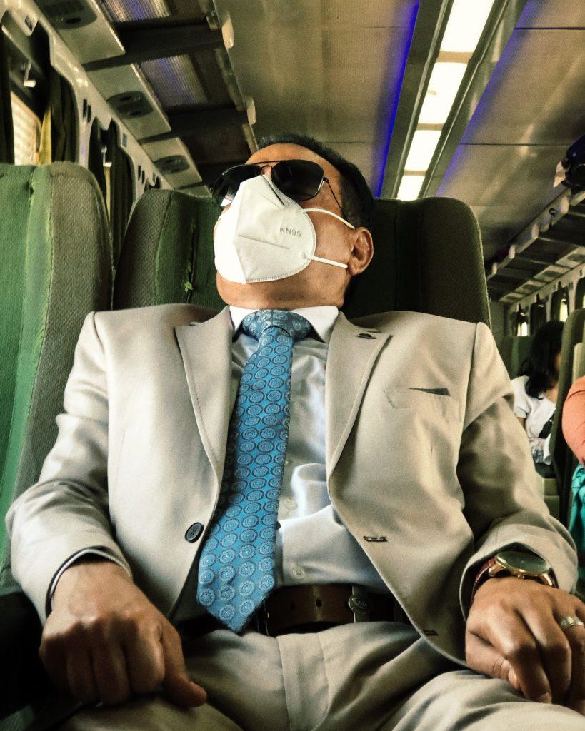 A man takes a nap before going his work in Alexandria, Cairo Alexandria train.